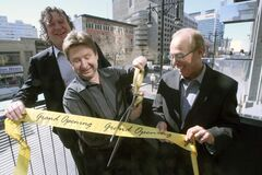 Winnipeg developer Mark Hofer, his brother Rick and Mayor Sam Katz cut the ribbon to kick start The Avenue, a new condo development in downtown Tuesday.