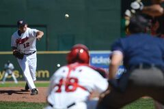 The  Goldeyes' Zach Baldwin throws a pitch.