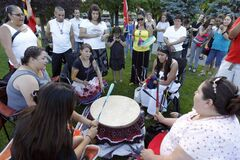 Drummers play at a vigil held for Carolyn Sinclair, Lorna Blacksmith and Tanya Nepinak, at Memorial Park, Saturday.