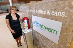 Marta Mikita-Wilson with her SodaStream display at Richardson International Airport. Starter kits sell for $100 to $279.