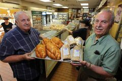 Brothers Arthur (left) and Bernie Gunn display their famous baked goods.