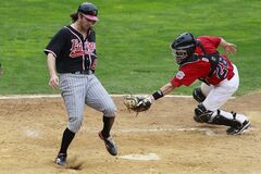 Winnipeg Goldeye Kyle Day (28) misses tagging Fargo-Moorhead Redhawks Zach Penprase (6). Goldeyes were defeated 15-1.