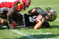 University of Manitoba Bisons receiver Xavier Johnson is crunched Saturday at University Stadium.