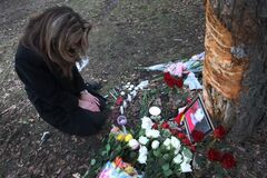 Jacqueline Romanow mourns at the scene of the crash that killed her daughter, Kelvin High School student Julia Romanow, 17.
