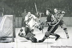 Winnipeg's Pete Kapusta (19) pots a goal for the Providence Reds during the 1949 season.
