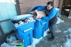 Raymond Ares shows recycling that Emterra has not picked up at 300 Selkirk Ave. in more than two weeks.