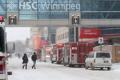 Hazmat units are on the scene on William Avenue along with several emergency vehicles and police officers in front of the main entrance to the Health Sciences Centre for a unknown incident Saturday morning.  Traffic on William Avenue is closed. Jan 19, 2013, Ruth Bonneville  (Ruth Bonneville /  Winnipeg Free Press)