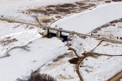 This aerial photo of the floodway gates along the Red River in St. Norbert, taken Wednesday, shows the huge amount of snow awaiting the spring melt.