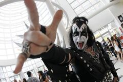 Fan Craig Henckel as Gene Simmons of Kiss at the MTS Centre Thursday.