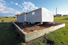 A home on the Sioux Valley Dakota Nation lies blown off of its foundation by a suspected tornado on Thursday evening. Two people were taken to hospital after the storm blew through the reserve during supper hour.