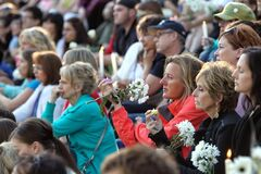 Mourners attend a candlelight vigil in memory of Lisa Gibson and her two children, two-year-old Anna and three-month-old Nicholas, at The Forks Thursday evening.