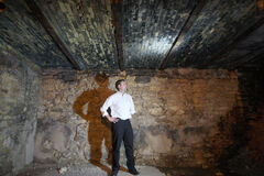 Daniel Lojo in his basement which is under a city of Winnipeg sidewalk at 216 Pacific,
