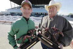 Top rider Paul Nolan (left) and top trainer Ardell Sayler show off their hardware.