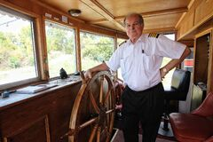 Paddlewheel Queen owner and captain Steve Hawchuk on the bridge before setting off Sunday. He promises he and the big boat are done for good this time.