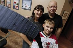 Cheryl and Brian Broszeit, with their son Tylo, won the right to have interpreters on sports teams.