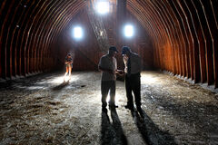 Two brothers reminisce in an old barn as a granddaughter plays with a kitten in Ruth Bonneville's award-nominated photo.