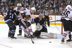 Chicago Blackhawks' Brandon Saad tries to shoot the puck into the Jets' net during the first period Saturday.