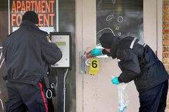 Police investigators examine the blood left behind at the Capri apartment building at 2130 Portage Ave. where they found three people suffering from various injuries Friday night. Two of the victims, a 42-year-old male and a 32-year-old female, were taken to hospital in stable condition. A third victim, a 39-year-old male, suffered upper body injuries and was taken to hospital in critical condition. He later died as a result of those injuries.