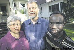 Lois Coleman Neufeld and her husband, Rob Neufeld, with Jackson Nahayo.