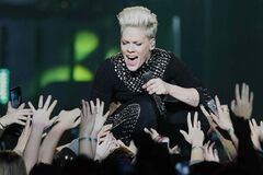 Pink embraces her front-row fans as she performs at the MTS Centre Tuesday evening, part of her three-continent Truth About Love tour.