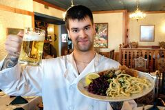 Owner and head chef Jereme Labelle, with the Bratwurst Appetizer and the Platter of Schnitzels.