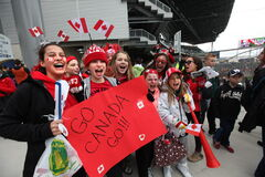 Young Manitoba provincial team soccer players start cheering for their favourite team on the steps of the stadium Thursday just before Canada takes on Team USA at the women's international soccer match at Investors Group Field.