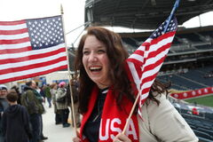Rachel Leiphon from Grand Forks patriotically holds up her US flags before the start of Canada v USA Women's International soccer match at Investors Group Field.
