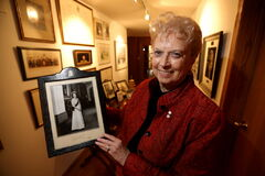 Former Manitoba lieutenant-governor Pearl McGonigal — seen here with an autographed photo of Queen Elizabeth II — has many fond memories of royal visits, including submitting a personal cheesecake recipe for an official meal.