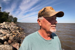 East Delta Beach resident Dennis Nodrick looks at Lake Manitoba Monday.