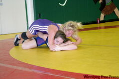 Liz Sera (top) and Aislynn Torfason on the mat in the championship final at the recent Toronto showdown. Sera took the gold.