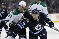 Winnipeg Jets' Bryan Little (18) attempts to get around Dallas Stars' Jordie Benn (24) during second period NHL action in Winnipeg on Friday, October 11, 2013.