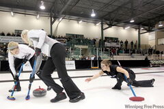 Sweepers Leslie Wilson and Raunora Westcott brush Kristen Phillips' stone during Sunday afternoon's Scotties final in Killarney. The three curlers asked Jill Thurston to skip the team and the recruitment drive paid off with a Manitoba women's title and a berth in the Scotties Tournament of Hearts in Sault Ste. Marie, Ont., which starts Jan. 30.