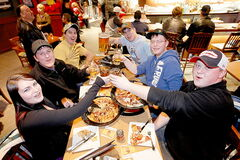 Friends enjoy a good time at Boston Pizza in cityplace, which pulls in a good crowd before events at MTS Centre. 4Play hopes to do the same.