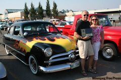 George McConnell, with wife Irene, was voted the Fabulous 50's Ford Club of Manitoba's annual Cruiser of the Year. McConnell rarely misses a local car show in his flamed-out 1949 'Shoebox' Ford and always has a smile and encouraging words for his fellow auto enthusiasts.