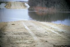 Tire tracks on Alarie Road lead into the Marsh River where Raymond Stott tried to cross.