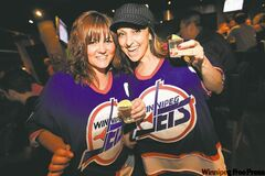 Nikki Fuhro (left) and Viola Bauer raise their glasses to the prospect of Winnipeg getting its own NHL team again.