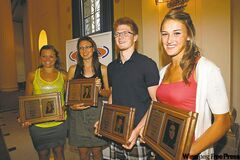 Scholarship winners Melanie Edel, Alexandra Warburton, Noah Derksen and Taylor Pischke (from left).