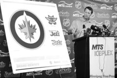 Jets owner Mark Chipman unveils team's new logo on July 22.