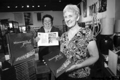 Charlotte Penner (left) and Betty Reimer with copies of Mennonite Girls Can Cook.