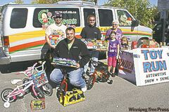 From left: Rob Swaffer of the MSRSRA with Keith Anderson and Llew Taylor from the MB LX Car Club (the club donated four children's bicycles to the MSRSRA's annual Toy Run) along with Sandra Knight of the MSRSRA and her grandaughters Kara and Cailen Yackel.