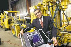 Hemant Shah with a Cubex drill to be shipped to Saudi Arabia. Collaborating has paid off for Cubex.