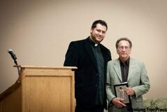 Rev. Fr. Ted Paraskevopoulos presents guest speaker, renowned mosaic iconographer Robert Andrews, with a gift.