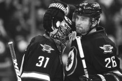 Jets goalie Ondrej Pavelec gets congratulated by teammate Blake Wheeler after Friday�s 4-2 victory over Boston.