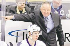 Maple Leafs boss Randy Carlyle barks instructions behind Carter Ashton during a recent game. While his gruff ways haven't changed, the coach has promised a kinder, gentler attitude and not to rehash things after games.'I think it's important that's one of the things that I learn and change right off the bat.'