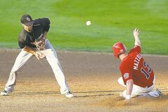 Goldeye Josh Mazzola beats the throw to Sioux City's Ryan Priddy at second base Monday night.