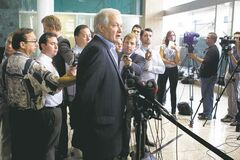 Donald Fehr (centre), executive director of the NHLPA, speaks to journalists following talks in Toronto on Wednesday.