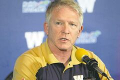 New head coach Tim Burke answers questions from the media on Saturday at Canad Inns Stadium.