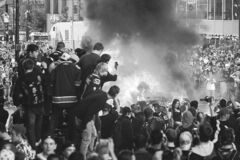Vancouver hockey fans watch a car burn during a riot in 2011.