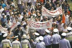 Anti-Japan protesters march through the street towards the Japanese Consulate General in Shanghai, China.