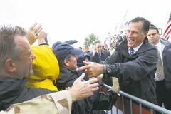 Mitt Romney greets supporters at a campaign rally at Victory Landing Park in Newport News, Va., on Monday.